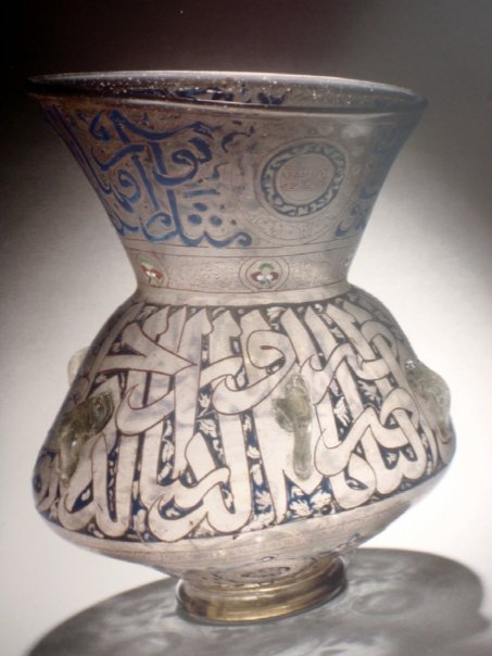 Lamp inscribed with the name of Sultan Hassan Egypt, 1347-1361 Glass, blown, enameled and gilded Loan from the Musee du Louvre, Dept. of Islamic Art, former Spitzer collection